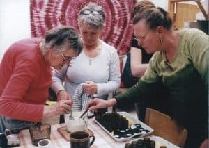 Judith_hoad_making_tincture_from_medicinal_herbs